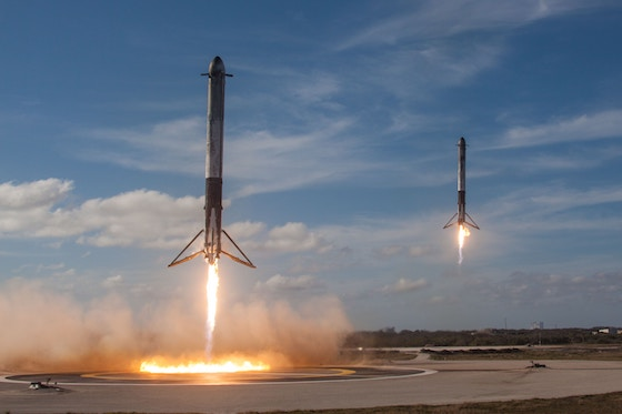 Two rockets launching into space.