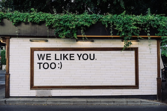 Billboard saying 'we like you.'