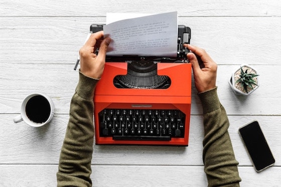 orange typewriter and coffee.