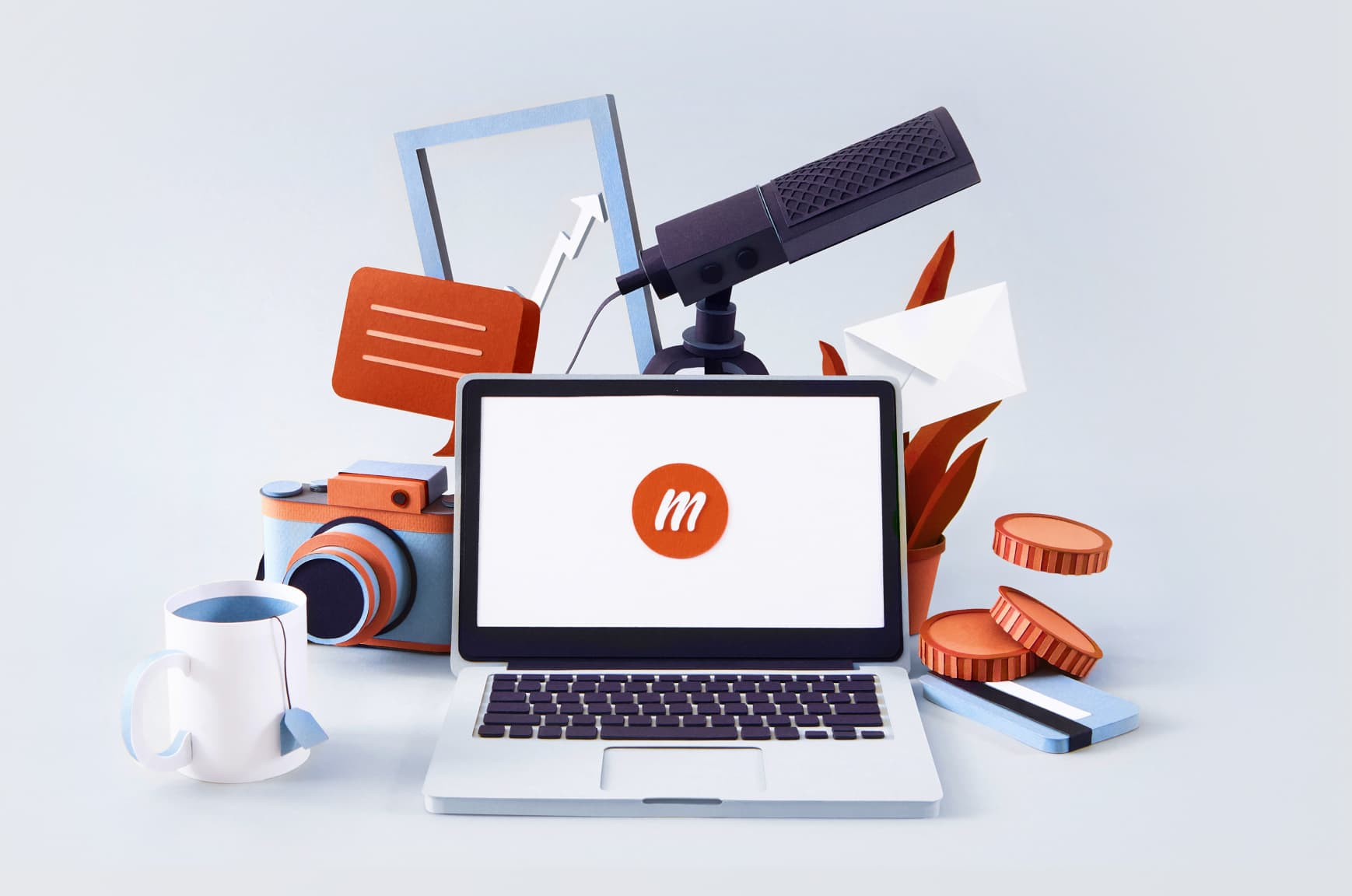 Paper illustrations of a laptop with a memberful logo surrounded by a teacup, camera, microphone, and more.